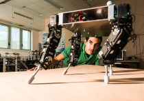 A researcher training a robot at Ben Gurion University's ABC Robotics Initiative