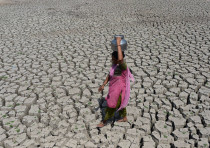 A woman carries water on her head in India during one of the worst droughts in decades.