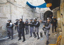 Border police confront protestors in the Old City of Jerusalem.