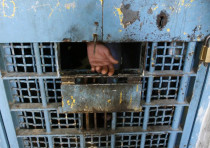 The hand of a Palestinian inmate is seen in a prison in the West Bank city of Nablus February 11, 20