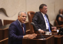 Yesh Atid leader Yair Lapid at the Knesset plenum discussing goverment allowances for the handicap,