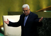 Palestinian President Mahmoud Abbas greets delegates after addressing the 72nd United Nations
