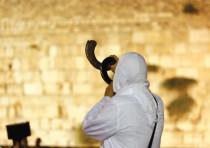 A Jewish man praying at the Western Wall