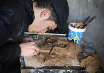 A CHRISTIAN man in Iraq creates miniature replicas of statues destroyed by Islamic State when they o