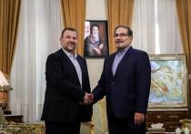 Saleh al-Arouri (L), Hamas deputy chief, shakes hands with Ali Shamkhani, secretary of Iran's Nation
