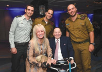 MIRIAM AND Sheldon Adelson pose with IDF soldiers in New York.