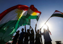 Iraqi Kurds wave flags of Iraqi Kurdistan during a demonstration