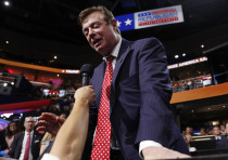 President Donald Trump's campaign manager Paul Manafort talks to the media during his campaign