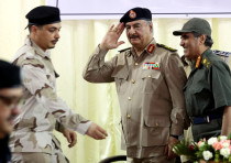 Libya's eastern-based commander Khalifa Haftar salutes as he participates in General Security confer