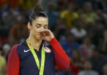 Aly Raisman receives a silver medal at the 2016 Olympics in Rio de Janeiro, Brazil.