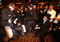 Extremist haredi men protest against jail sentences for draft dodgers.