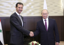 Russian President Vladimir Putin (R) shakes hands with Syrian President Bashar al-Assad during a mee
