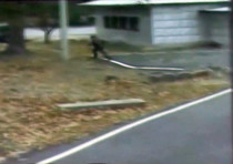 A North Korean soldier crosses the white Military Demarcation Line while he chased a defector