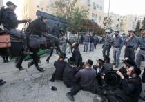 Haredi men protest outside the draft office in Jerusalem on November 28.