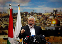 Hamas Chief Ismail Haniyeh gestures as he delivers a speech over U.S. President Donald Trump's decis