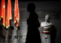A woman walks past a bust of Soviet leader Joseph Stalin in an exhibit dedicated to the Battle of St