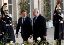 French President Emmanuel Macron welcomes Israeli Prime Minister Benjamin Netanyahu in Paris