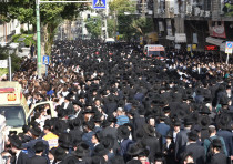 Haredim (ultra-Orthodox) walk through Bnei Brak during the funeral procession of Rabbi Aharon Leib S