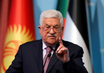 Palestinian Authority President Mahmoud Abbas speaks during a news conference following the extraord