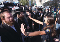 Haredi rioters affiliated with extremist communities block traffic at a Jerusalem junction