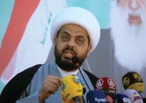 QAIS AL-KHAZALI, leader of the Iran-supported force Asaib Ahl al-Haq, speaks during a celebration