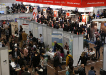 People visit the second job fair for migrants and refugees in Berlin, Germany.