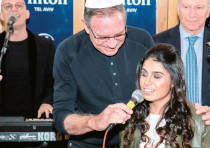 VARIETY ISRAEL chairman Ori Slonim holds the microphone for singer Eden Taharany at last week's Tel