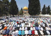 MUSLIMS PRAY next to Al-Aqsa Mosque in Jerusalem.