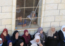 Women react during the funeral of Palestinian Ahmad Saleem in the West Bank.