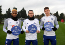 Chelsea FC players Charly Musonda, Eden Hazard, and Ross Barkley participate in the team's initiativ