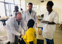Medical professionals from Sheba Medical Center and Zambia work together to treat a child as part of