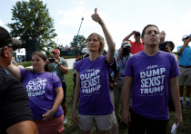 Protesters wearing anti-Trump shirts the presidents misogyny.