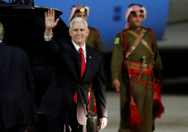 US Vice President Mike Pence waves to the media after his arrival at Amman military airport, Jordan