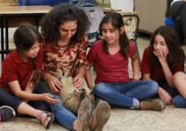 Arab-Israeli pupils participate in Hakol Chai's animal compassion program.