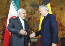 BELGIAN FOREIGN MINISTER Didier Reynders (right) welcomes his Iranian counterpart.