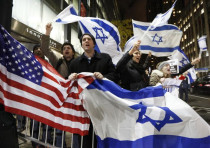 People hold U.S. and Israel flags as they chant during a Pro-Israel rally.