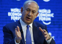 Prime Minister Benjamin Netanyahu attends a session during the 2016 World Economic Forum in Davos