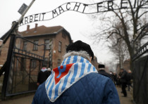 Holocaust survivors enter Auschwitz 73 years after its liberation on Holocaust Remembrance Day, Janu