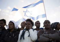 African migrants take part in a protest against Israel's detention policy toward them