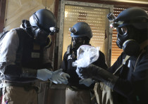 UN chemical weapons experts inspect alleged chemical samples from an attack in Syria, 2013