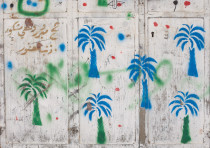 The palm tree is a Muslim symbol of fertility, and signifies the resident's return from Mecca