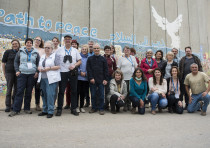 ICEJ group in front of the security barrier that shields Netiv HaAsara from Gazan sniper fire