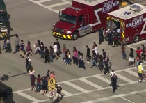 Students are evacuated from Marjory Stoneman Douglas High School during a shooting incident in Parkl