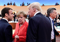 US President Donald Trump, German Chancellor Angela Merkel and French President Emmanuel Macron at t