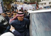 Qatari Ambassador to Gaza Mohammed al-Emadileaves following a press conference in Gaza