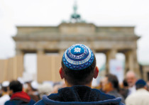 A MAN wearing a kippa waits for the start of a demonstration against antisemitism at Berlin's Brande
