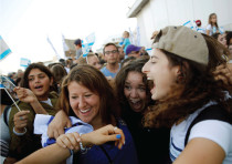 AN 'OLAH HADASHA' from North America (right) reacts as she is welcomed after landing at Ben-Gurion I