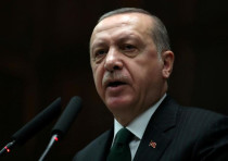 Turkish President Tayyip Erdogan addresses members of parliament from his ruling AK Party (AKP) duri