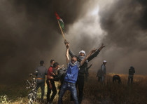 Palestinians burn tires during protests in Gaza