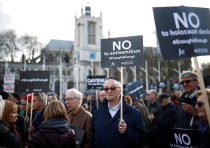 Protesters participate in a demonstration against antisemitism in Parliament Square in London